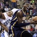 Indiana Pacers' Ian Mahinmi, right, drives past Charlotte Bobcats' Al Jefferson, left, during the first half of an NBA basketball game in Charlotte, N.C., Wednesday, Nov. 27, 2013. (AP Photo/Chuck Burton)