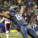 In this Nov. 27, 2011, file photo, Seattle Seahawks wide receiver Golden Tate celebrates his touchdown against the Washington Redskins in the second half of an NFL football game in Seattle. Tate received a 15-yard unsportsmanlike conduct penalty for falli