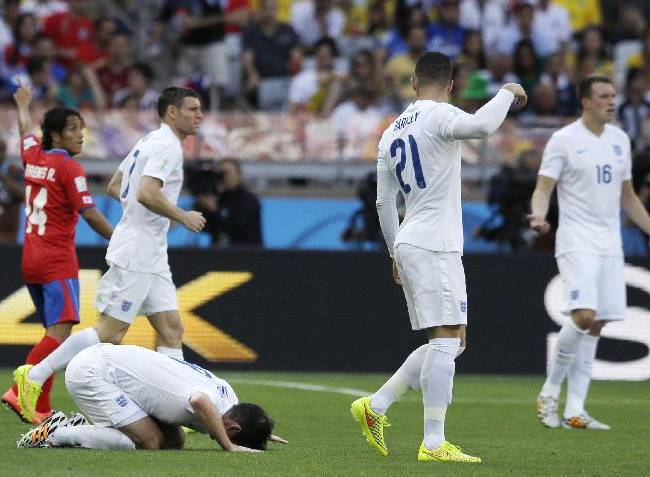 England's Frank Lampard sinks to the ground after a challenge during the group D World Cup soccer match between Costa Rica and England at the Mineirao Stadium in Belo Horizonte, Brazil, Tuesday, June 24, 2014