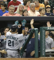 Seattle Mariners' Franklin Gutierrez (21) is welcomed back to the dugout after hitting a two-run homer against the Houston Astros in the fourth inning of a baseball game Thursday, Aug. 29, 2013, in Houston. (AP Photo/Pat Sullivan)