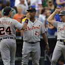 Detroit Tigers first baseman Miguel Cabrera (24) is congratulated by Detroit Tigers third base coach Dave Clark (25) and Detroit Tigers first base coach Omar Vizquel (31) after defeating the Kansas City Royals in a baseball game Saturday, Sept. 20, 2014, in Kansas City, Mo. (AP Photo/Reed Hoffmann)