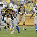 Pittsburgh Steelers wide receiver Antonio Brown (84) runs away from Detroit Lions free safety Louis Delmas (26) on his way to a touchdown in the first quarter of an NFL football game on Sunday, Nov. 17, 2013, in Pittsburgh The Associated Press