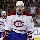 Montreal Canadiens center Daniel Briere (48) celebrates Dale Weise's goal against the Boston Bruins during the first period in Game 7 of an NHL hockey second-round playoff series in Boston, Wednesday, May 14, 2014 The Associated Press