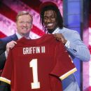 Baylor quarterback Robert Griffin III, right, poses for photographs with NFL Commissioner Roger Goodell after he was selected as the second pick overall by the Washington Redskins in the first round of the NFL football draft at Radio City Music Hall, Thursday, April 26, 2012, in New York. (AP Photo/Jason DeCrow)