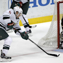 Minnesota Wild left wing Zach Parise (11) shoots the puck at Anaheim Ducks goalie Jonas Hiller (1), of Switzerland in the third period of an NHL hockey game Wednesday, Dec. 11, 2013 in Anaheim, Calif. Ducks won 2-1 The Associated Press