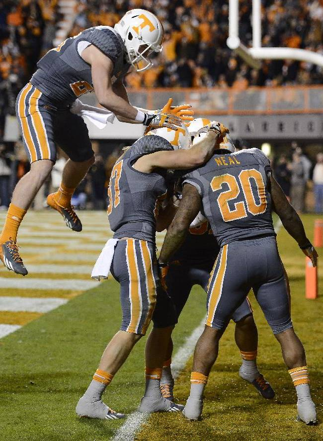 Tennessee running back Rajion Neal (20) celebrates with teammates after scoring on 5-yard run against Vanderbilt in the second quarter of an NCAA college football game on Saturday, Nov. 23, 2013, in Knoxville, Tenn