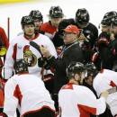 Ottawa Senators coach Paul MacLean talks to the team during practice ahead of Game 5 in their NHL hockey Stanley Cup playoffs Eastern Conference semifinal against the Pittsburgh Penguins in Ottawa, Ontario, on Tuesday, May 21, 2013. (AP Photo/The Canadian Press, Patrick Doyle)