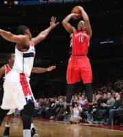 WASHINGTON, DC - JANUARY 3: DeMar DeRozan #10 of the Toronto Raptors shoots against Kevin Seraphin #13 of the Washington Wizards during the game at the Verizon Center on January 3, 2014 in Washington, DC. (Photo by Ned Dishman/NBAE via Getty Images)