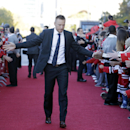 Chicago Blackhawks right wing Marian Hossa greets fans as he arrives at the United Center before an NHL hockey game against the Buffalo Sabres in Chicago, Saturday, Oct. 11, 2014 The Associated Press