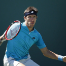 Leonardo Mayer, of Argentina, returns the ball to Kevin Anderson, of South Africa, during their match at the Miami Open tennis tournament in Key Biscayne, Fla., Sunday, March 29, 2015. (AP Photo/J Pat Carter)