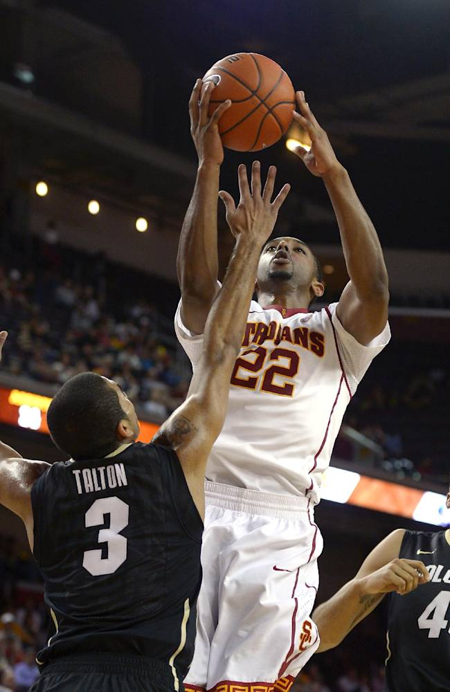 Southern California guard Byron Wesley, right, puts up a shot as Colorado guard Xavier Talton defends during the second half of an NCAA college basketball game, Sunday, Feb. 16, 2014, Los Angeles