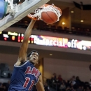Loyola Marymount's Nick Stover dunks during the first half of a West Coast Conference tournament NCAA college basketball game against Santa Clara, Friday, March 8, 2013, in Las Vegas. (AP Photo/Isaac Brekken)