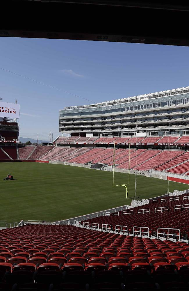 In this July 17, 2014, file photo, a groundskeeper drives across the field before the ribbon-cutting and opening of Levi's Stadium, in Santa Clara, Calif. The San Francisco 49ers prepare for their first preseason game at new Levi's Stadium on Sunday when they host the Denver Broncos