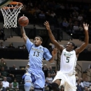 Marquette guard Vander Blue (13) goes up for a dunk after getting past South Florida guard Jawanza Poland (5) during the first half of an NCAA college basketball game Wednesday, Feb. 6, 2013, in Tampa, Fla. (AP Photo/Chris O'Meara)