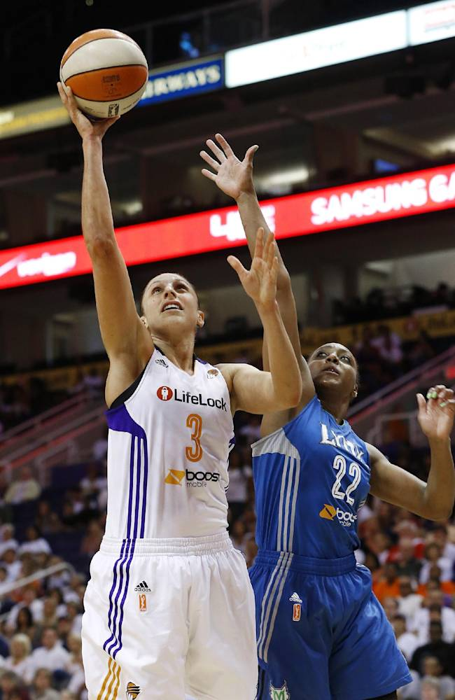 Phoenix Mercury's Diana Taurasi (3) scores as she gets past Minnesota Lynx's Monica Wright (22) during the second half in a WNBA Western Conference Finals basketball game on Sunday, Sept. 29, 2013, in Phoenix. The Lynx defeated the Mercury 72-65 and won the Western Conference Finals 2-0, earning a trip to the WNBA Finals to face the Atlanta Dream