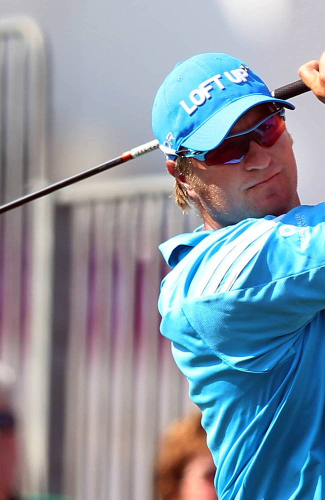 Dawie Van Der Walt of South Africa hits his tee shot on the 10th hole during the second round of the Commercial Bank Qatar Masters at the Doha Golf Club in Doha, Qatar, Thursday, Jan. 23, 2014