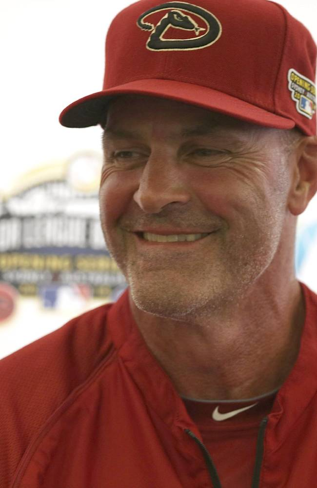 The Arizona Diamondbacks' manager Kirk Gibson laughs during a press conference at the Sydney Cricket Ground in Sydney, Tuesday, March 18, 2014. The MLB season-opening two-game series between the Los Angeles Dodgers and Arizona Diamondbacks in Sydney will be played this weekend