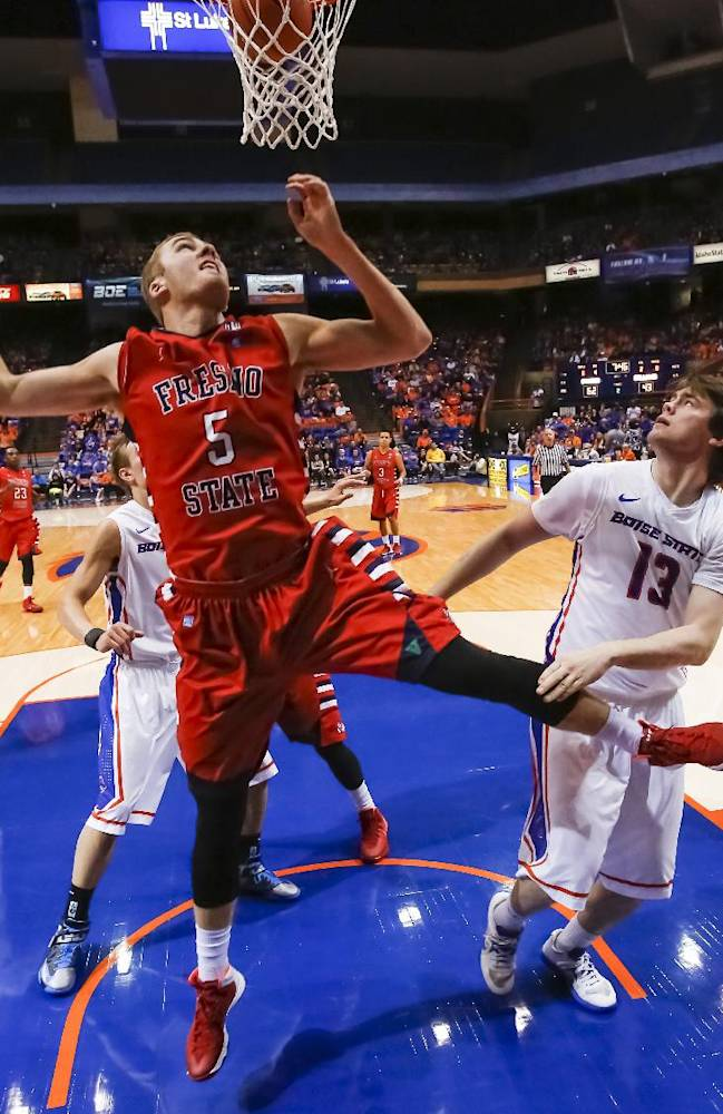 Fresno State's Tanner Giddings (5) watches the ball drop through the basket after shooting over Boise State's Nick Duncan (13) during the second half of an NCAA college basketball game in Boise, Idaho, on Saturday, Jan. 4, 2014. Boise State defeated Fresno State 86-79