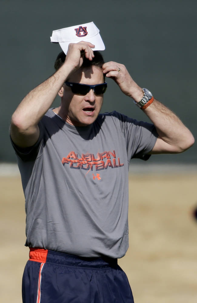 Auburn coach Gus Malzahn watches NCAA college football practice on Friday, Jan. 3, 2014, in Irvine, Calif. Auburn is scheduled to play Florida State on Monday in the BCS national championship game