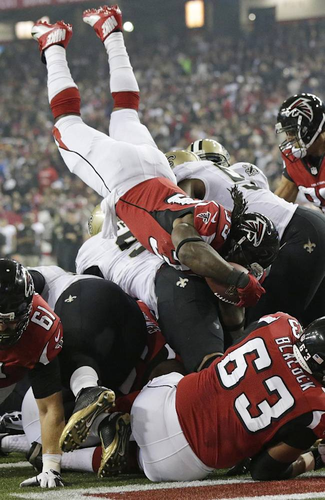 Atlanta Falcons running back Steven Jackson (39) keeps into the end zone for a touchdown against the New Orleans Saints during the first half of an NFL football game, Thursday, Nov. 21, 2013, in Atlanta
