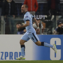 Manchester City's Pablo Zabaleta celebrates after scoring his side second goal during a Group E Champions League soccer match between Roma and Manchester City at the Olympic stadium in Rome, Italy, Wednesday Dec.10, 2014