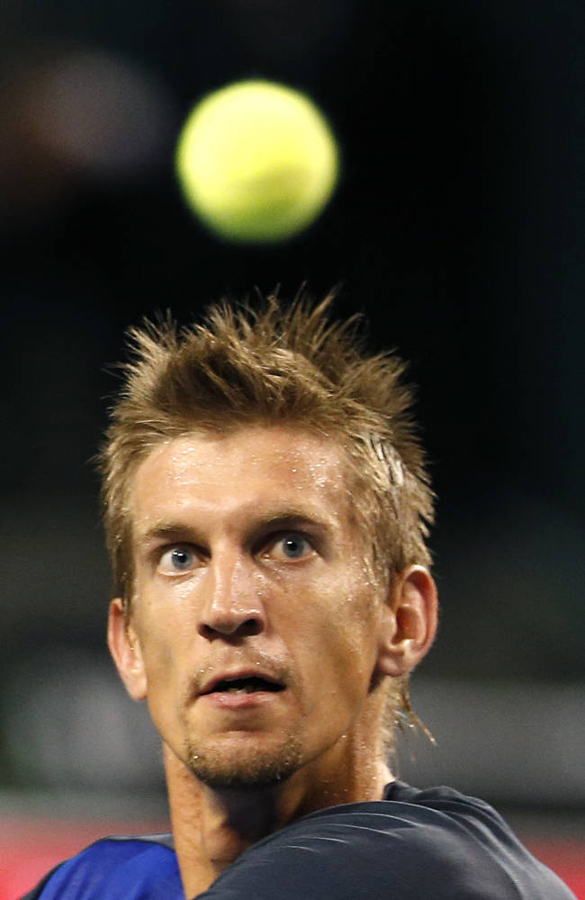 Jarkko Nieminen of Finland eyes the ball to return to Ivan Dodig of Croatia during the quarterfinal of the Japan Open Tennis Championships in Tokyo, Friday, Oct. 4, 2013