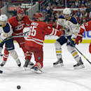 Carolina Hurricanes' Riley Nash (20), Ron Hainsey (65) and Justin Faulk (27) chase the puck against Buffalo Sabres' Tyler Ennis (63) and Matt Moulson (26) during the first period of an NHL hockey game in Raleigh, N.C., Tuesday, Oct. 14, 2014 The Associate