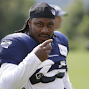 FILE -In this Aug. 2, 2014, file photo, Seattle Seahawks running back Marshawn Lynch walks on the field during NFL football training camp in Renton, Wash. Police in Bellevue, Washington, are investigating whether Lynch was involved in an assault and damag