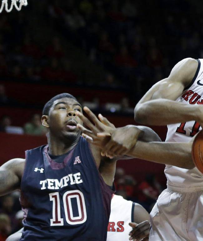 Rutgers forward Kadeem Jack (11) grabs for a loose ball in front of Temple forward Mark Williams (10) during the first half of an NCAA college basketball game in Piscataway, N.J., Wednesday, Jan. 1, 2014