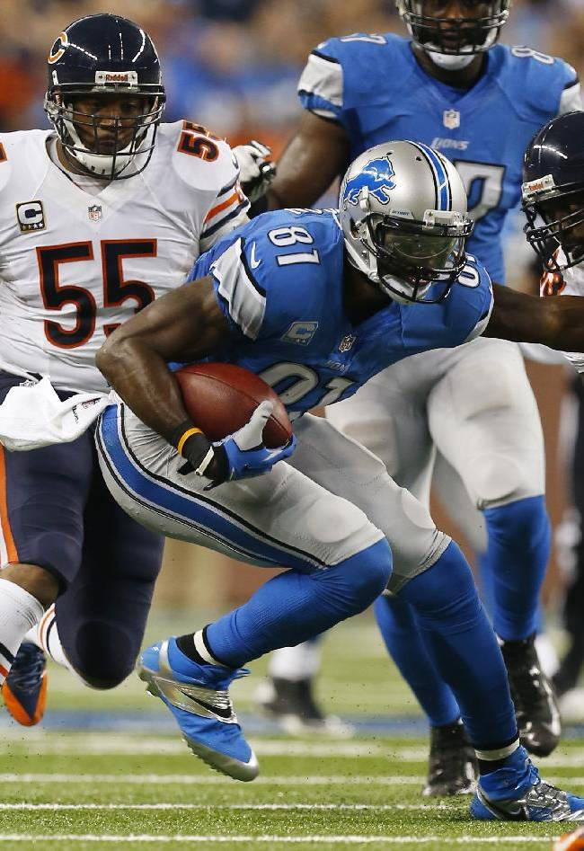 Chicago Bears cornerback Charles Tillman (33) and outside linebacker Lance Briggs (55) close in on Detroit Lions wide receiver Calvin Johnson (81) during the first quarter of an NFL football game at Ford Field in Detroit, Sunday, Sept. 29, 2013