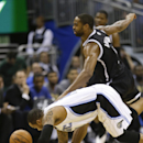 Orlando Magic's Jameer Nelson, left, and Brooklyn Nets' Deron Williams go after a loose ball during the second half of an NBA basketball game in Orlando, Fla., Wednesday, April 9, 2014. Orlando won 115-111 The Associated Press