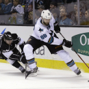 San Jose Sharks' Brent Burns (88) is chased by Los Angeles Kings' Trevor Lewis (22) during the second period of an NHL hockey game Wednesday, Jan. 21, 2015, in San Jose, Calif The Associated Press