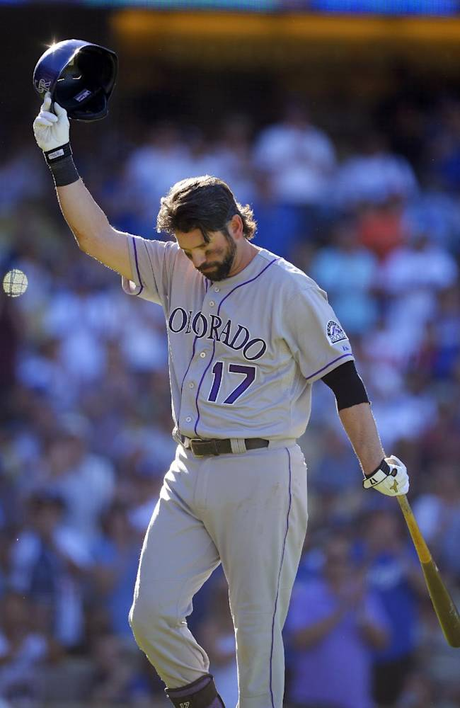 Colorado Rockies' Todd Helton acknowledges fans after striking out in his last at-bat, during the ninth inning of the Rockies' baseball game against the Los Angeles Dodgers, Sunday, Sept. 29, 2013, in Los Angeles