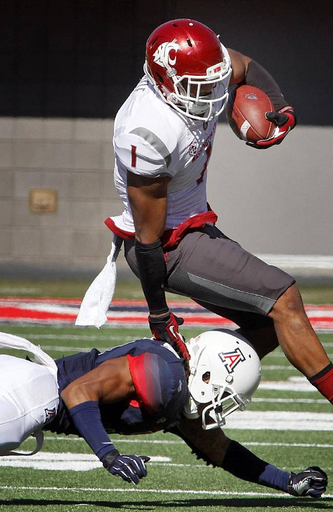 Washington State's Vince Mayle (1) avoids the tackle by Arizona's Shaquille Richardson, left, in the first half of an NCAA college football game on Saturday, Nov. 16, 2013 in Tucson, Ariz
