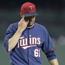 Minnesota Twins relief pitcher Jared Burton (61) walks of the mound at the end of the seventh inning, after giving up the go-ahead run during an exhibition baseball game against the Boston Red Sox in Fort Myers, Fla., Thursday, March 27, 2014 The Associat