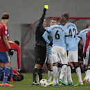 Referee Istvan Vad shows the yellow card to Manchester City's Fernando for a foul during the Champions League Group E soccer match between CSKA Moscow and Manchester City at Arena Khimki stadium in Moscow, Russia, Tuesday Oct. 21, 2014