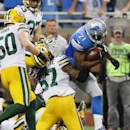 Detroit Lions running back Reggie Bush (21) breaks through the defense of Green Bay Packers inside linebacker Jamari Lattimore (57) for a 26-yard rushing touchdown during the second half of an NFL football game in Detroit, Sunday, Sept. 21, 2014 The Assoc