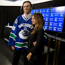 Vancouver Canucks' goalie Ryan Miller, left, stands for a photo with his wife, actress Noureen DeWulf following a news conference after he signed a three-year contract with the NHL hockey team, Tuesday, July 1, 2014 in Vancouver, British Columbia The Asso