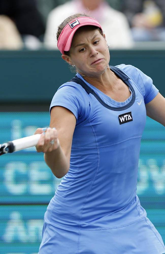 Jana Cepelova, of Slovakia, returns to Andrea Petkovic, of Germany, during the final of the Family Circle Cup tennis tournament in Charleston, S.C., Sunday, April 6, 2014. Petkovic won 7-5, 6-2