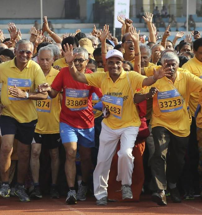 Elderly Indians begin their run as they participate in the TCS World 10K Bangalore 2014 run for senior citizens in Bangalore, India, Sunday, May 18, 2014. According to organizers, the event had eight races with total prize money of USD 170,000