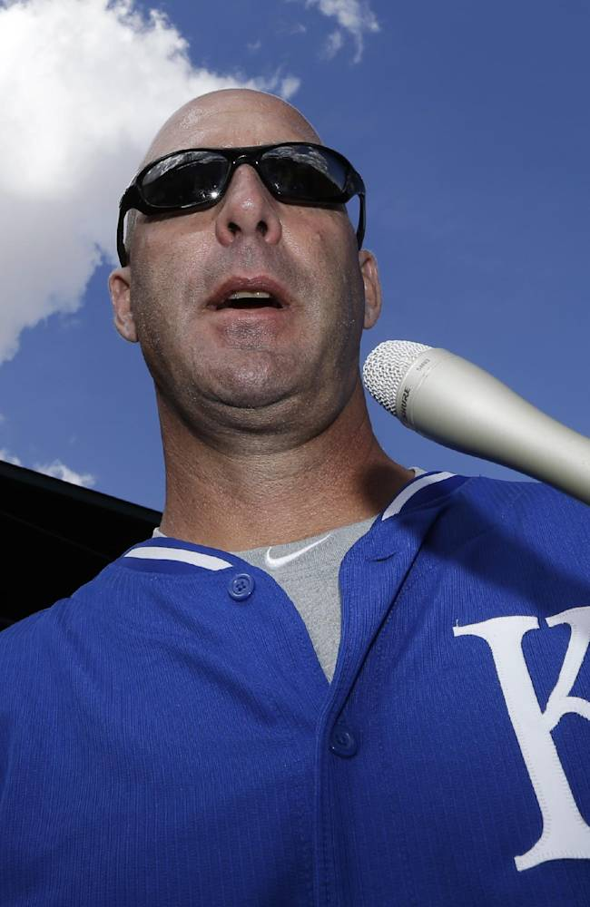 Former Chicago Cubs manager and current Kansas City Royals third base coach Dale Sveum talks to reporters before a spring exhibition baseball game on Sunday, March 2, 2014, in Mesa, Ariz