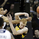 No. 23 Iowa holds off Notre Dame 98-93 The Associated Press