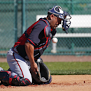 Atlanta Braves catcher Gerald Laird blocks the ball as it bounces off his mask during baseball spring training Tuesday, Feb. 18, 2014, in Kissimmee, Fla The Associated Press