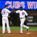 Chicago Cubs third baseman Kris Bryant (17) and center fielder Dexter Fowler celebrate the Cubs' 5-3 win against the St. Louis Cardinals in the second baseball game of a doubleheader, Tuesday, July 7, 2015, in Chicago. (AP Photo/David Banks)