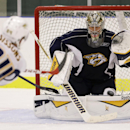 Nashville Predators goalie Pekka Rinne, right, of Finland, watches a shot by forward Colton Sissons (84) during NHL hockey training camp Friday, Sept. 19, 2014, in Nashville, Tenn The Associated Press
