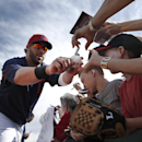 Cleveland Indians' Jason Kipnis signs autographs before the Indians' exhibition baseball game against the Cincinnati Reds in Goodyear, Ariz., Wednesday, Feb. 26, 2014 The Associated Press