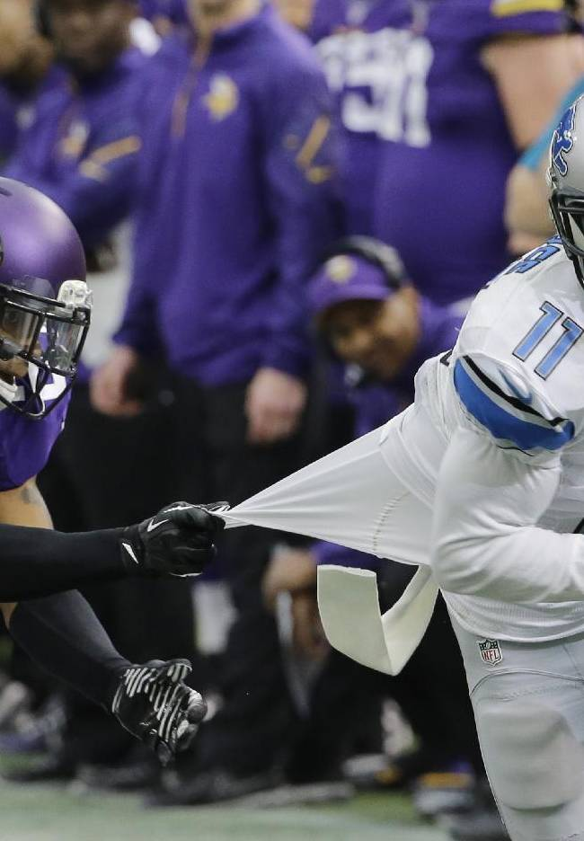 Detroit Lions wide receiver Kevin Ogletree (11) runs from Minnesota Vikings cornerback Shaun Prater after making a reception during the second half of an NFL football game, Sunday, Dec. 29, 2013, in Minneapolis