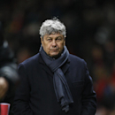 Donetsk's coach Mircea Lucescu walks from the pitch at the end of their Champions League group A soccer match between Manchester United and Shakhtar Donetsk at Old Trafford Stadium, Manchester, England, Tuesday, Dec. 10, 2013