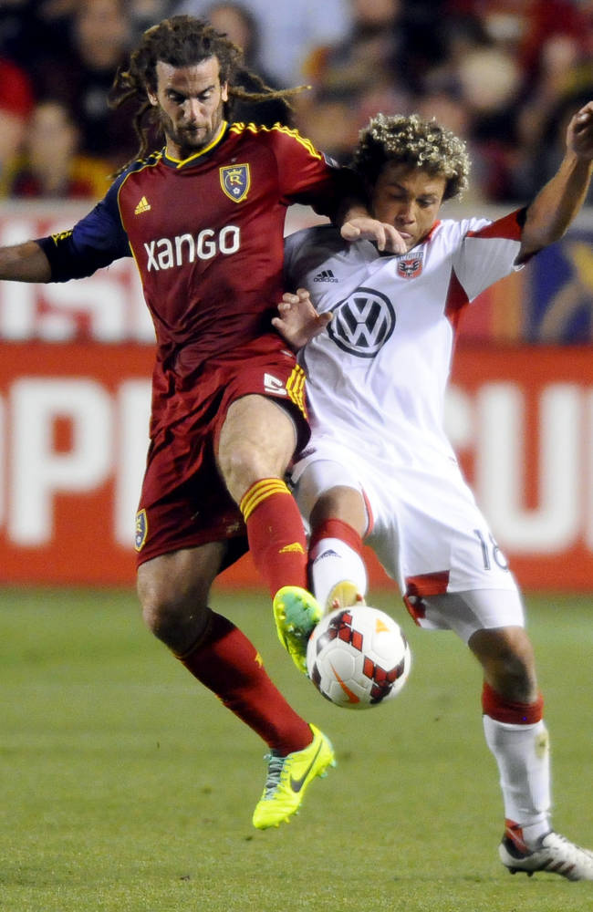 Real Salt Lake's Kyle Beckerman, left, and D.C. United's Nick DeLeon fight for control of the ball in the first half of the U.S. Open Cup of Soccer final, Tuesday, Oct. 1, 2013, in Sandy, Utah