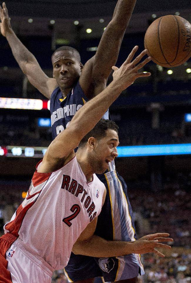 Toronto Raptors forward Landry Fields (2) is fouled by Memphis Grizzlies forward Ed Davis during the first half of a preseason NBA basketball game in Toronto on Wednesday, Oct. 23, 2013